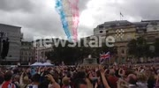 Red arrows fly over cheering crowds in trafalgar square