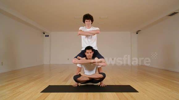 Vinyasa yoga women hold 1 foot 1 arm out