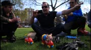 Cancer patient Artist Taxi Driver pushes toy pig  to Downing Street to protest NHS privatisation