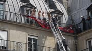 Femen Taken off Roof by Paris Firemen above Far Right Demo