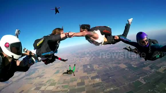Two people get married during a skydive