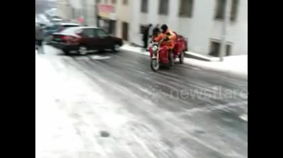 Motortricycle loses control on icy road