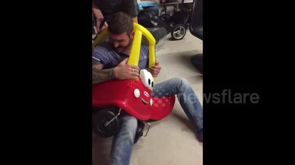 Hilarious man stuck in a toy car
