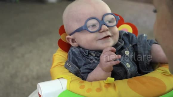 Baby sees his mother clearly for the first time after getting glasses