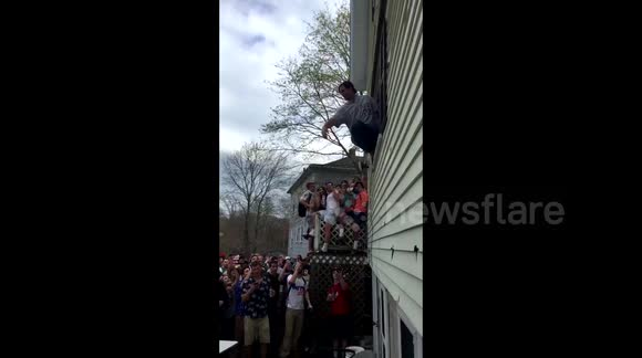 Partying student jumps out of a window onto a table