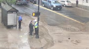 Springfield, MA Water Main Break/ Sinkhole  May 4, 2016 2:16 Elderly Couple Trying to cross the Street . Authorities tell them they cannot. See another video of authorities leading the couple across the street through another location.