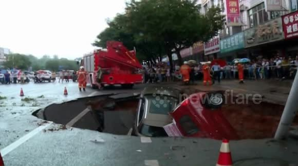 Sinkhole 'swallows' four cars in China