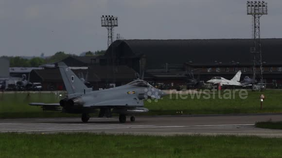 Rear tyres fail on RAF jet fighter as it takes off