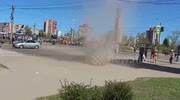 Dust devil forms in Russian street