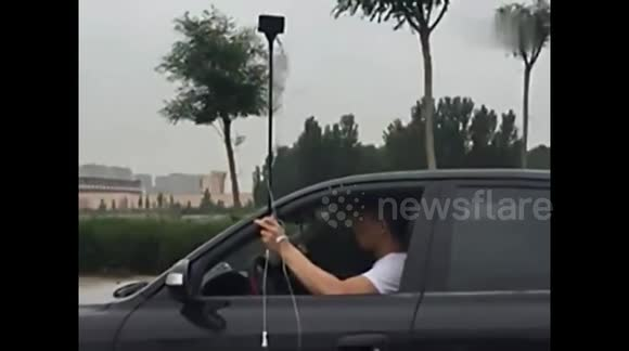 Man attached to IV drip drags it down the road while driving