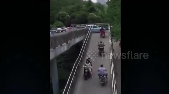 Car drives onto pedestrian bridge and nearly gets stuck