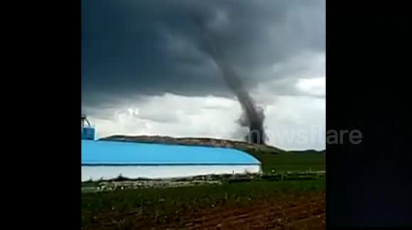 Massive tornado hits southern China