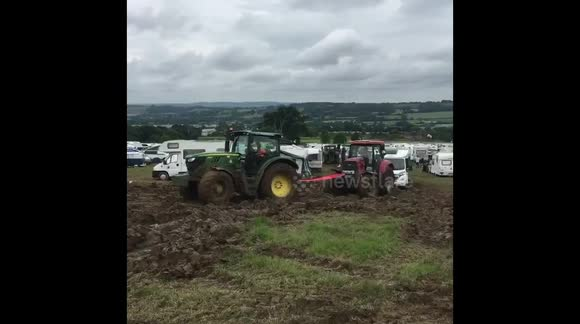 Tractor pulling a tractor pulling a campervan gets stuck at Glastonbury