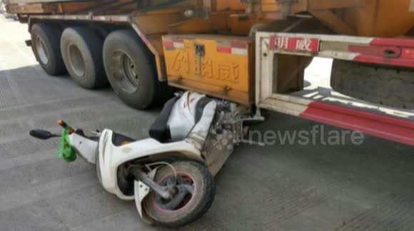 Moped driver narrowly escapes being crushed by lorry
