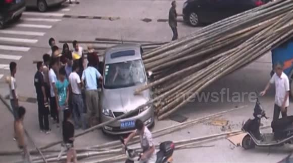 Tractor driver brakes suddenly causing bamboo sticks to pierce car