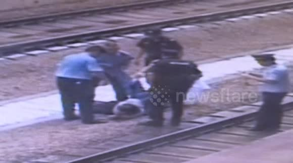 Man pushed onto train tracks escapes being run over