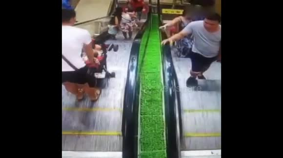 Baby in buggy rolls down escalator