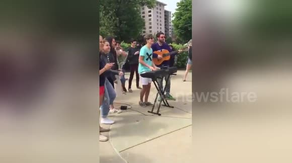 Newsflare Romantic Youngster Performs Ed Sheeran Song For Prom