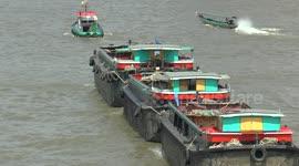 Newsflare - Barges on Bangkok's Chao Phraya River
