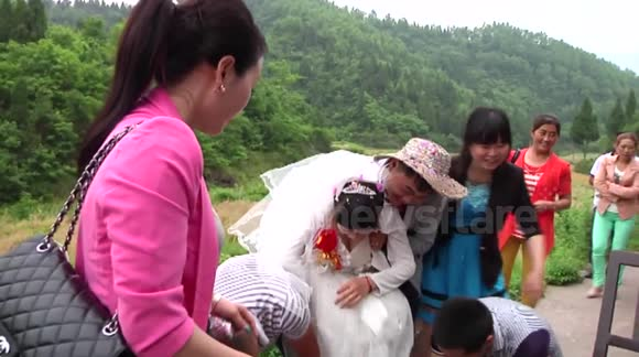 Bride goes to wedding on cement trolley