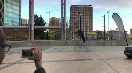 Newsflare - Man glides over seafront like Iron Man with hi-tech jetpack