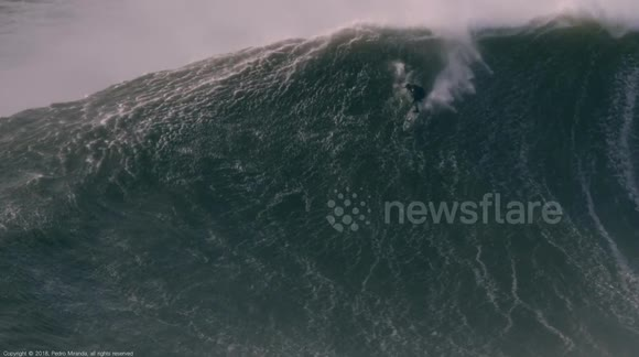 Newsflare Drone Captures Giant Wave Surfing And Dramatic