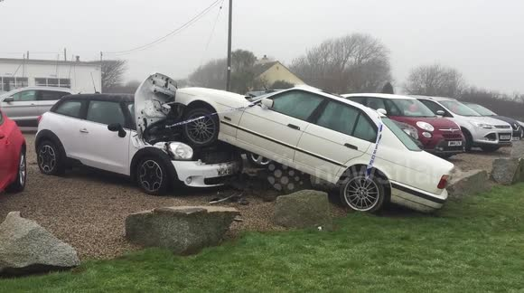 Newsflare Bmw Leaves Road And Crashes Into Mini On Garage Forecourt