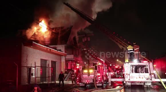 Newsflare - Fire Breaks Through the Roof at a Vacant House