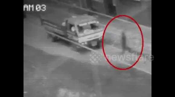 Newsflare - 'Ghost' caught on camera walking through traffic in the