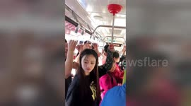 Newsflare - Woman strips on China bus after argument