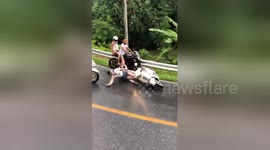 Newsflare - Moped Teens Crash Into Road Works Pit