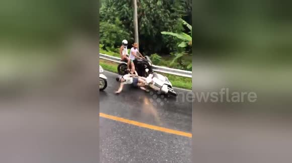 Newsflare - Motorcycle riders crash on slippery hill in