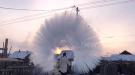 Newsflare - Hot water freezes in midair and turns into a