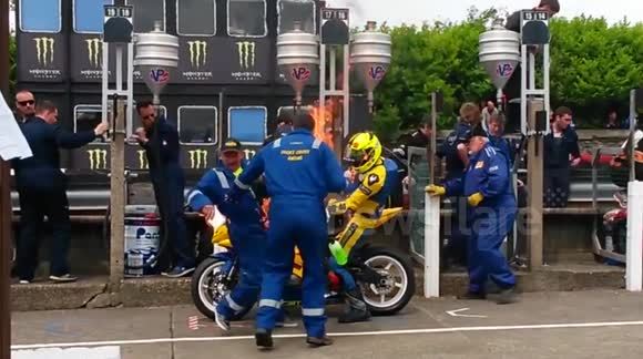 Rider and mechanic engulfed in flames at TT motorcycle race