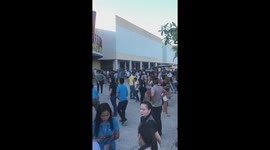 Newsflare - Shoppers run for cover as second earthquake hits the