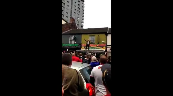 Newsflare - Football fan falls through bus stop roof while