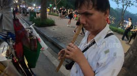 Newsflare - Artist plays music on gigantic flute