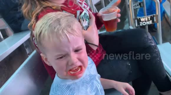 8bf7ac567b466 US toddler sobs after getting soaked by killer whale at Sea World in San  Diego