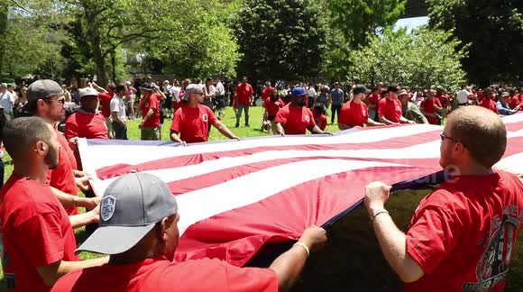 Newsflare - Memorial Day: Iron Workers fold massive U S  flag