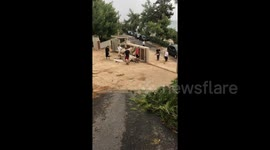 Newsflare - Tree felt on a car,after catastrophic storm in halkidiki