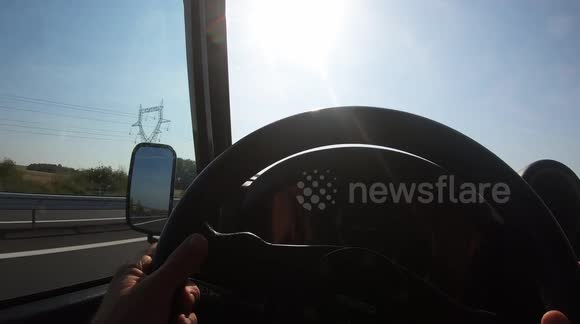 Newsflare - hyperlapse of a car driving on the motorway from