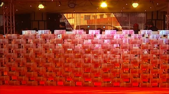 Company boss builds wall of MONEY to protect himself from angry staff after bankruptcy rumours