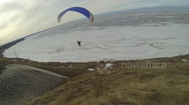 Newsflare - Man experiences terrifying paragliding accident in Austria