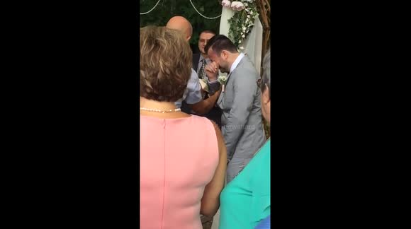 Groom overcome with emotion at the altar
