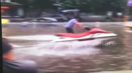 Newsflare - Man on jet-ski makes the most of flooding on