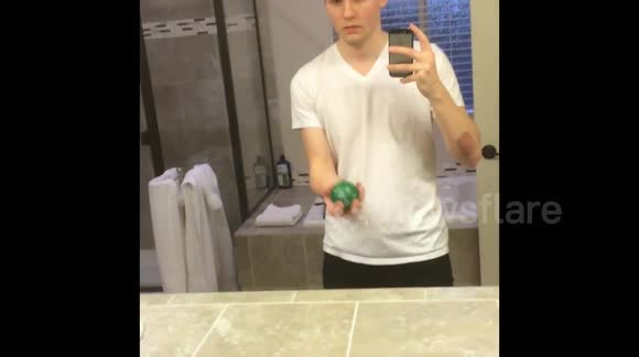 Man throws ball to himself through mirror in crazy optical illusion