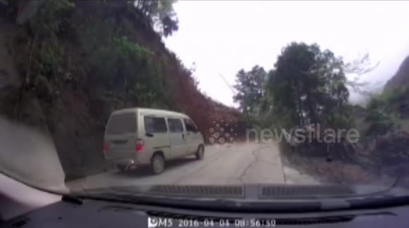 Landslide in China caught on dash-cam