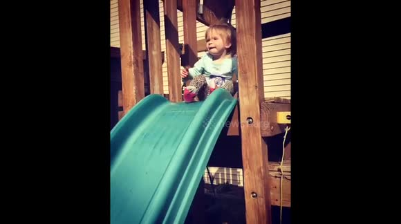 Toddler 'wipes out' on play area slide