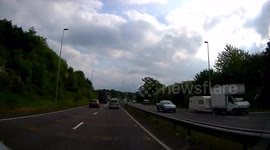 Newsflare - Dash Cam Car on its roof blocking road on the