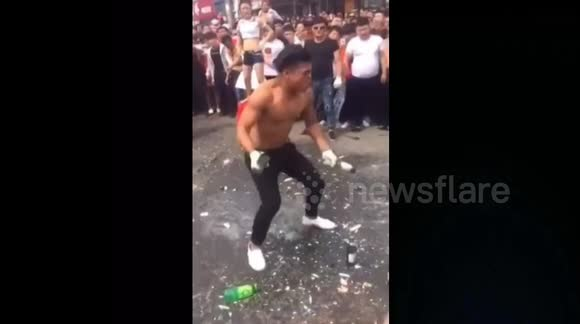 Man smashes bottles over his head to show how strong he is